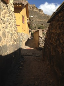 street of Ollantaytambo with ruins in the background