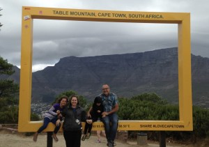 The Davi family at the top of signal hill, posing in a giant postcard.