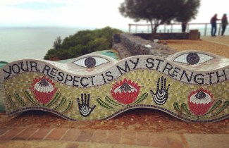 """sculpture at top of signal hill that reads """"your respect is my strength"""""""