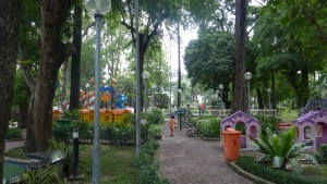 playground tucked into tall green trees in Ho Chi Minh City