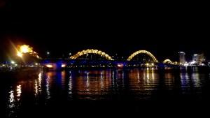 dragon bridge lit up gold at night
