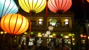 Colorful lanterns hang from buildings and across street in Hoi An