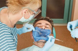 man undergoing a root canal