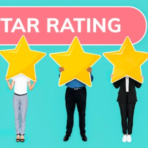 Diverse people showing golden star rating symbol