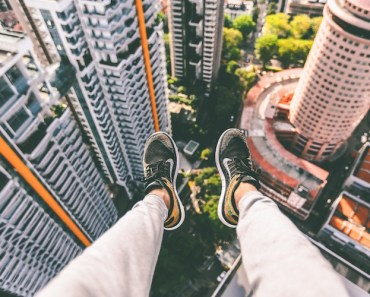 Feet Dangling From Skyscraper