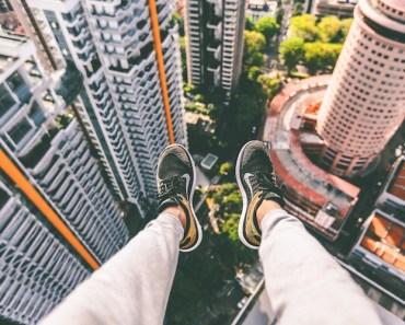 Feet Dangling From Skyscraper
