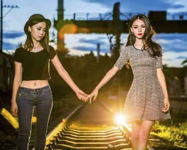 Girl Friends Walking Train Tracks