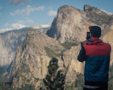 Solo Photographer with mountains