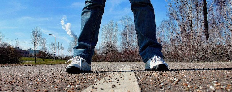 Legs Standing in the Road