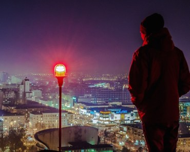 Man on Rooftop at Night