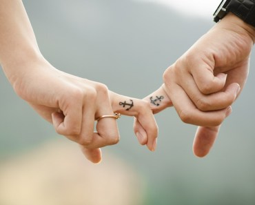 Hands Holding Fingers Tattoos