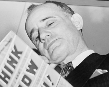Napoleon Hill holding book 1937