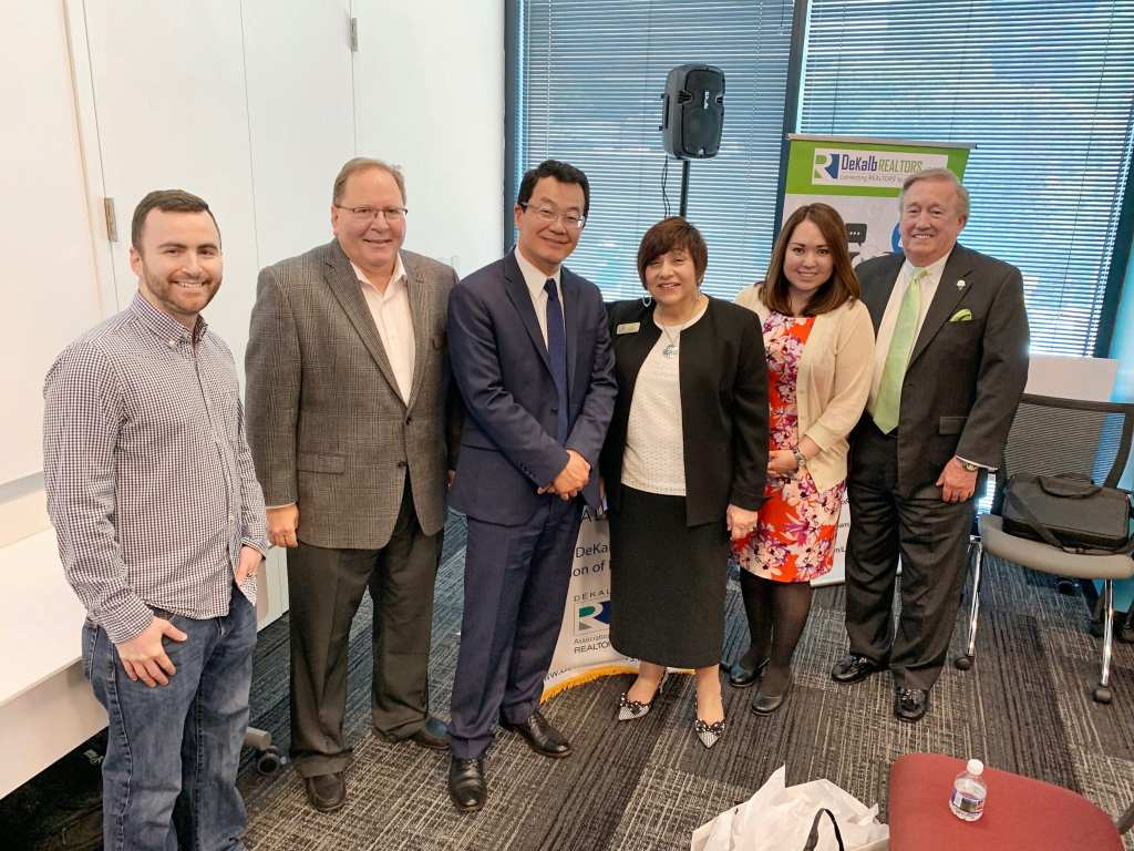 Dr. Yun, Chief Economist of the National Association of Realtors (third from left) shown with Sellect Realty co-owner Céline Lazarus (second from right) and the Cobb Association of Realtors.