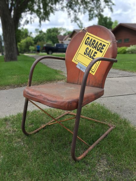 Garage sale sign on chair