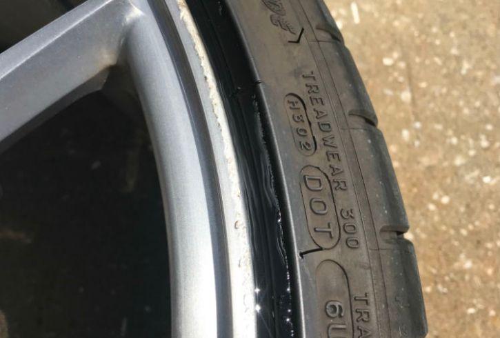 Close up of curb rash.