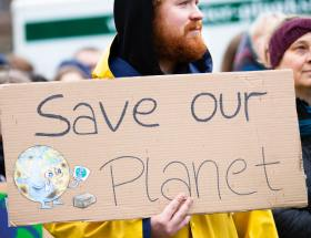 Cardboard sign, save our planet