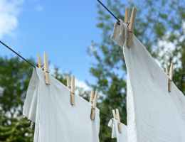 White sheets hanging from clothesline