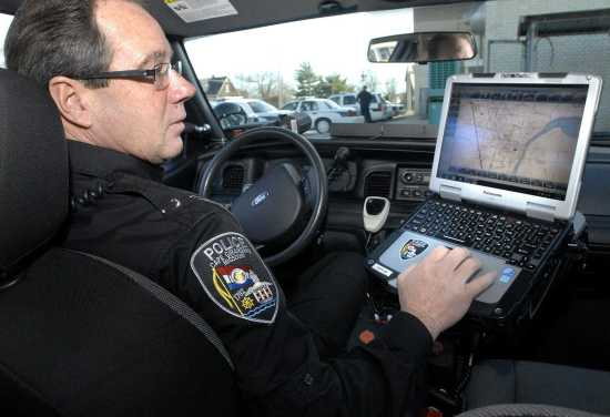Image result for image of cop car with computer in middle