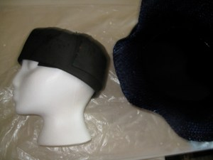 "In a perfect world, you will have a full range of sized hat and head blocks at your disposal. I don't, so I'm using a cheapy styrofoam wig head (you can get them at beauty supply stores). It's 22"", which is mighty small. I've padded it out with craft foam - just pin it into the head. I don't want to use batting or felt, because they hold water and are too squishy. Try to avoid lumps, which will show in the final hat."