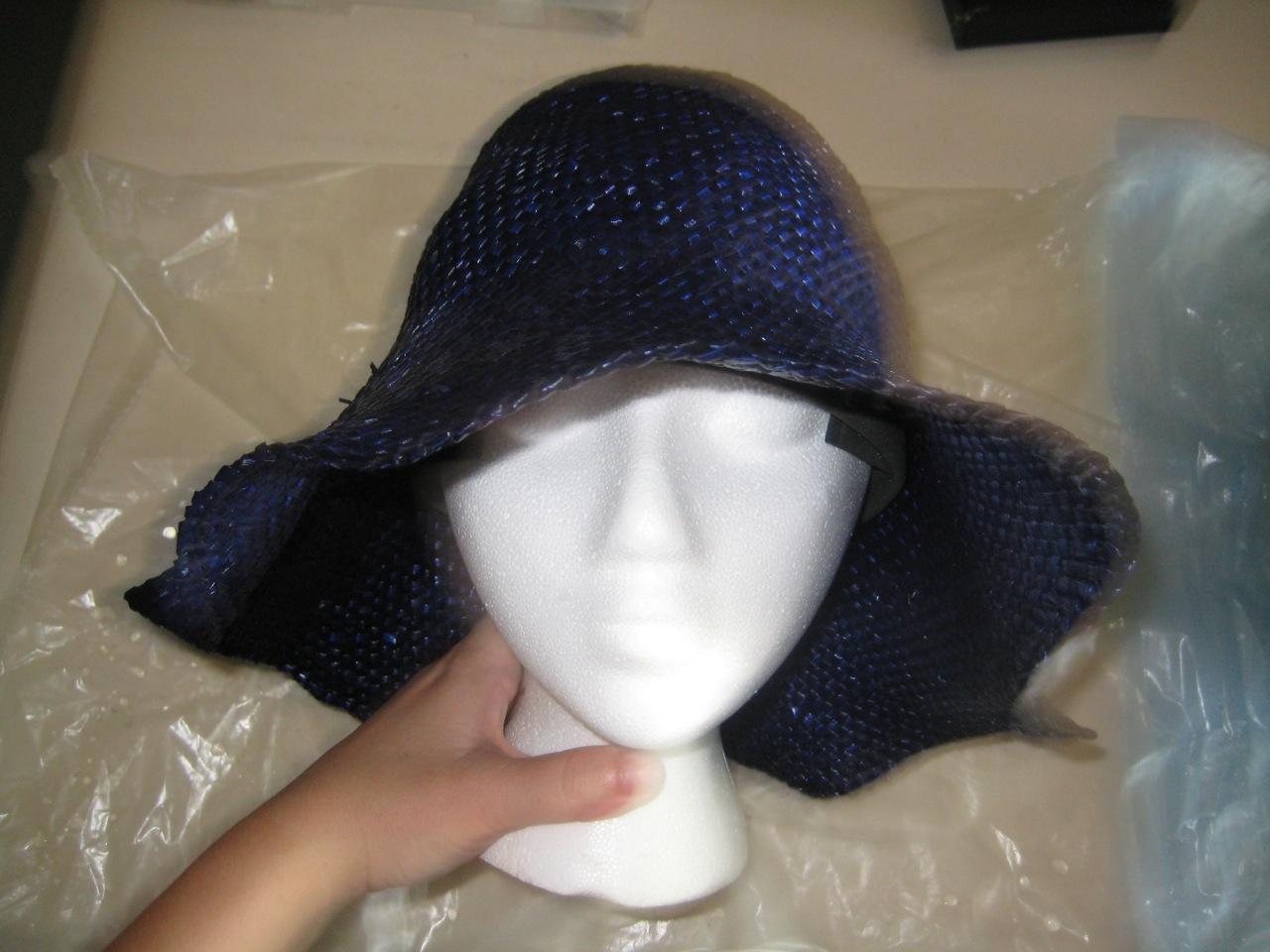b111bd3cd54 The hat must remain wet and pliable for the rest of the shaping