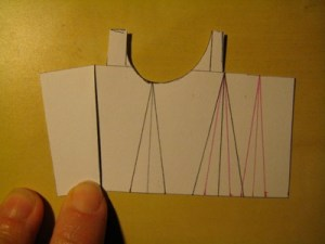 Fold the block back out so that the diagonal lines on either side of the mid-line remain touching.