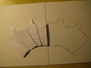 Trace around the paper block, and mark the location of the shaping lines.  Flip the block over, line it up, and repeat so that you have one whole, fit-able block.