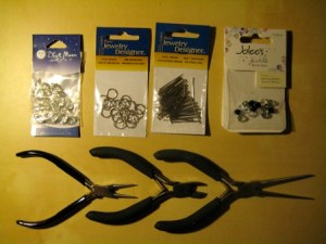 Clockwise, from upper left: Lobster Claws, Jump Rings, Nailheads, Beads, Long Pliers, Cutting Pliers, Rounded Pliers
