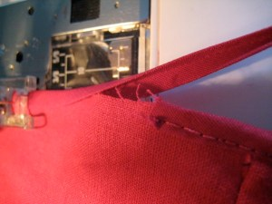 When you get close to the end, stop the machine with the needle down in the fabric/Bias Tape.