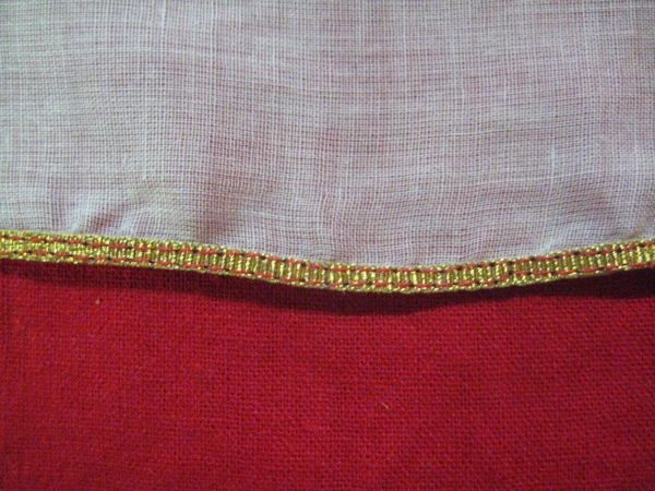 "A Ribbon Hem, front side, worked with 1/8"" wide gold grosgrain."