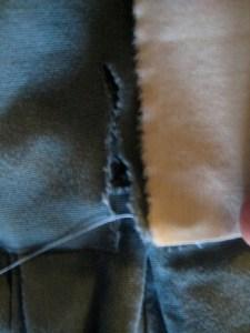 checking length of muslin against tear