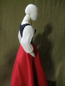 dressed doll, from side