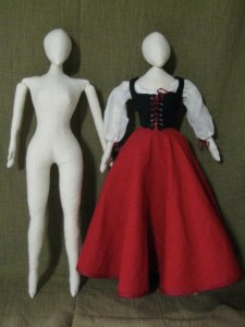 cloth dolls, one in costume
