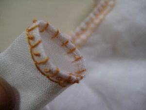 cuff bound with blanket stitches