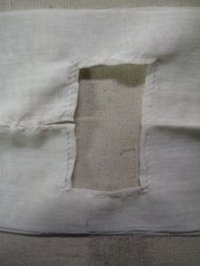 inside of neckline cut away