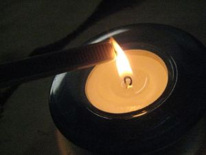 passing the edge of the boning through a candle flame