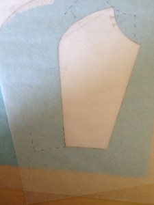 Move the tracing paper again so that the lower princess corner fits the bottom of the side back.  Mark out the waist and an inch of the side seam.