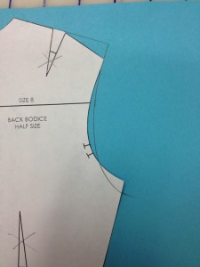 """Smoothly connect the extended shoulder line, the 1/8"""" guide, and the new bottom armscye point.  You will probably have to move your curved ruler during this process."""