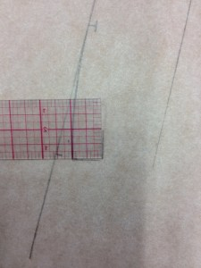 "Remember that we have a 1/2"" button placket on our blouse, so we have a built-in 1/2"" button extension in our collar.  We're going to square up a 1/2"" long line from the end of our collar, then square a 1/2"" line in towards the body.  (Checkpoint: this line should not become less than 1/2"" above the bottom curve of the collar.)"