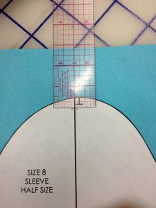 """We need to drop the sleeve cap 1/4"""" at the top for our half scale sample.  Give yourself a guide on the center line of the sleeve."""