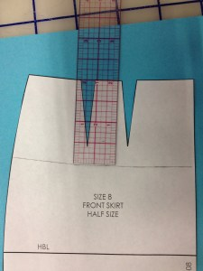 "The first thing to do is decide how deep the yoke should be.  We used 2"" for our halfscales.  Mark 2"" relative to the top of the skirt block.  Don't just draw a straight line across.  This part of your body isn't straight, and you'll get a frowny-face yoke if you try.  Measure several places relative to the top."