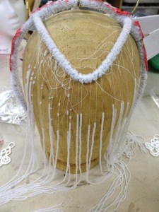 Started tying strands of beads to the front of the headdress - these will be the side sweep over the ear pieces.