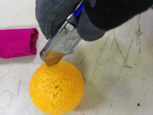 Cutting weird ball-thing.