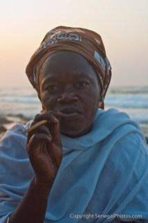 Jewelry seller taking a well deserved break from trading on the beach of Yoff virage, Dakar, Senegal. Photo by Marko Preslenkov.