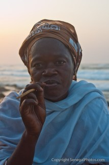 Jewelry seller taking a well deserved break from trading on the beach of Yoff virage, Dakar, Senegal. Photo by Marko Preslenkov.
