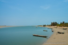 Atlantic ocean shores separating villages of Joal and Fadiout, one on mainland, the other an island, Senegal. Photo by Marko Preslenkov.