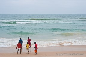 Kids enjoying the Atlantic ocean on N'Dar Tout beach in Saint-Louis, Senegal. Photo by Marko Preslenkov.
