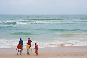 Kids enjoying the Atlantic ocean on N'Dar Tout beach in Saint-Louis, Senegal. Photo by Marko Preslenkov.