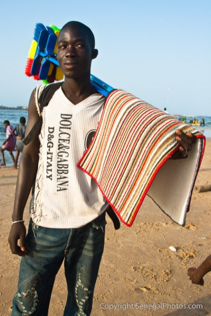 A young man hoping to do a bit of sales at Yoff fish market on the beach in Yoff, Dakar, Senegal. Photo by Marko Preslenkov.