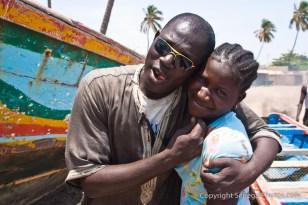 Marabou clinching his friend on the beach in Joal-Fadiout, Senegal. Photo by Marko Preslenkov.