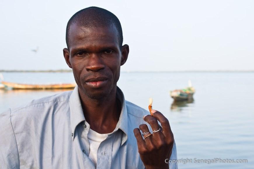 A Guinean man looking for better life in N'Dar Tout quarter of Saint-Louis, Senegal. Photo by Marko Preslenkov.